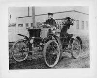 William Doud Packard driving Packard number two