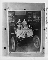 1901 Packard Model C on display, with young girls