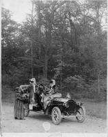 1907 Packard 30 Model U with three passengers and driver in the woods