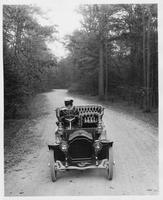 1907 Packard 30 Model U on wooded road with female driver