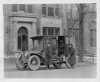 1908 Packard 30 Model UA limousine and owner Mr. Warfolk in front of Packard Company