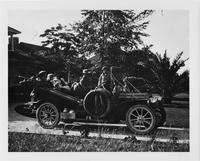 1908 Packard 30 Model UA with four passengers parked in driveway