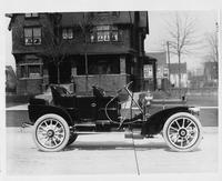 1908 Packard 30 Model UA close-coupled parked in front of brick house