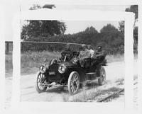 1909 Packard 30 Model UB with five male passengers on country road