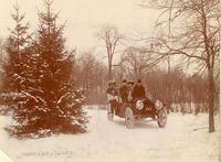 1909 Packard 30 Model UB in wooded area in winter with four passengers