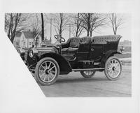 1909 Packard 18 Model NA touring car on residential street, left side view