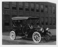 1909 Packard 30 Model UB close-coupled, right side, brick factory building in background