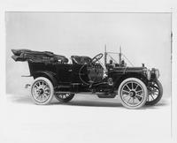 1910 Packard 30 Model UC touring car, three-quarter front view, right side, top lowered