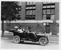 1911 Packard 30 Model UD touring car with male driver and six female passengers