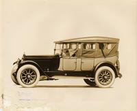 1911 Packard two-toned touring car with light colored folding top