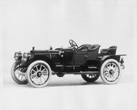 1912 Packard 30 Model UE runabout, five-sixth front view, left side, no top, with rumble seat