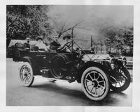 1912 Packard 30 Model UE touring car, parked on street with two couples