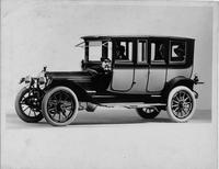 1913 Packard 48 two-toned brougham, right side, male driver & two female passengers