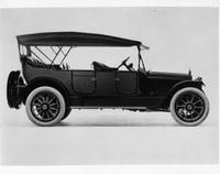 1913 two-toned Packard, left side, spare tires carried at back
