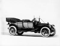 1913 Packard 38 touring car, three-quarter front view, right side, top folded