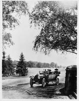 1913 Packard 48 phaeton, on country road, male driver, female and male passengers