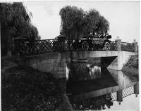 1914 Packard 2-38 salon touring car, driving on a stone bridge over water