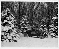 1914 Packard 2-38 phaeton runabout, on a forested snowy road