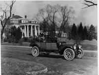 1914 Packard 3-48 touring car on residential street, mansions in background