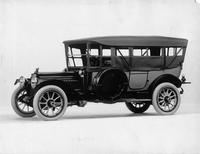 1914 Packard 48 touring car, left side, top raised, curtains closed