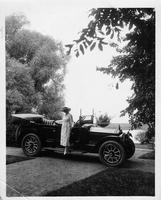 1917 Packard phaeton, parked on pathway, female stepping out of passenger side door