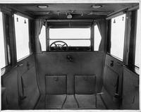 1917 Packard landaulet, view of interior from rear seat, shown with forward auxiliary seats folded