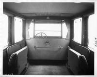 1917 Packard brougham, view of interior from rear seat, shown with side auxiliary seats folded