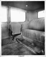 1917 Packard brougham, view of rear interior from right side door, showing side auxiliary seat folded