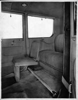 1917 Packard landaulet, view of rear interior from left side door, showing side-folding auxiliary seat