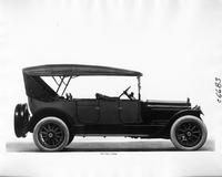 1917 Packard two-toned touring car, right side view, top raised with back side curtains