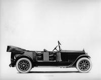 1918 Packard two-toned salon touring car, top folded, both doors opened, leather interior visible