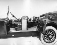 1918 Packard two-toned touring car, three-quarters back view, doors opened to view interior
