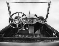 1918 Packard touring car, view from back seat of front steering panel, windshield, and seat
