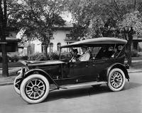 1918-1919 Packard touring car, parked on residential street