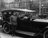 1920 Packard phaeton, man in military uniform standing alongside