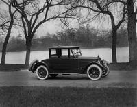 1921 Packard coupe, parked on road next to water and trees