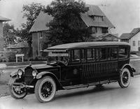 1921 Packard bus conversion parked on residential street