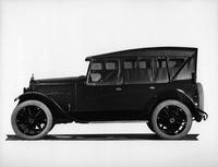 1921-1922 Packard touring car, left side view, top raised, storm curtains in place