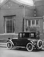 1921-1922 Packard coupe, parked on street in front of Frank Scott Clark Studio