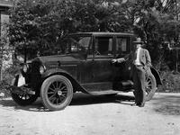 1921-1922 Packard coupe, three-quarter left front view, male owner standing at side