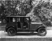 1921-1922 Packard sedan, parked in drive, right side view, doors open to reveal interior