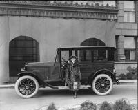 1920-1921 Packard sedan parked in front of stone building