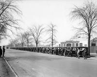 1920-1923 Packard touring cars, parked in front of Packard used car dealership