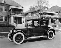 1920-1923 Packard special coupe with female driver parked on residential street