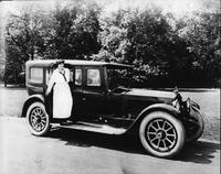 1920-1923 Packard touring car, woman in middy stepping out of passenger door