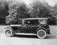 1920-1923 Packard touring car, on country road with male driver, California top