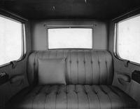 1920-1923 Packard duplex sedan, view of rear interior, close-up view of rear bench seat