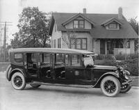 1920-1923 Packard special 5-door commuter bus parked on residential street