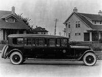 1920-1923 Packard special 8-door bus parked on residential street