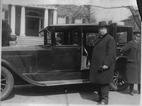 1922-1923 Packard sedan-limousine, chauffeur holding door for Justice William H. Taft